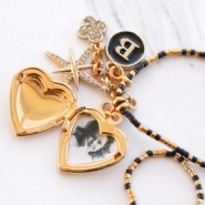 Inspirational Sets Create festive necklaces with medallion, rhinestone and letter charms